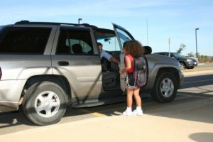 Little girl getting into car