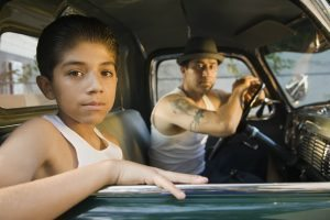 Boy with father inside a car