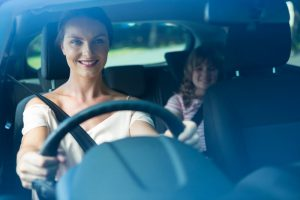 mother driving with child in backseat