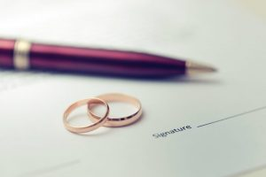 wedding rings and signature page