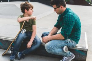 Father with son and skateboard