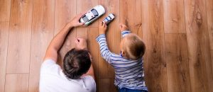 Father and child playing with cars