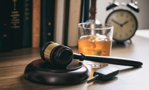 alcoholic drink next to a gavel