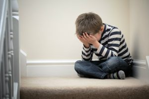 child crying in the corner