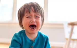 Little Boy crying by himself