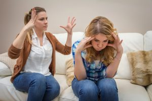 teenage girl arguing with mother